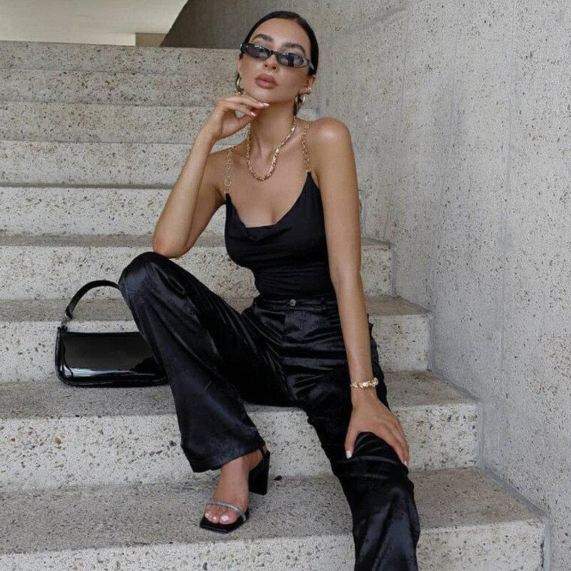 رداء علوي نسائي غير رسمي أنيق بدون أكمام بسلسلة سكيني بدلة قفز نسائية سوداء ملابس خروج نسائية