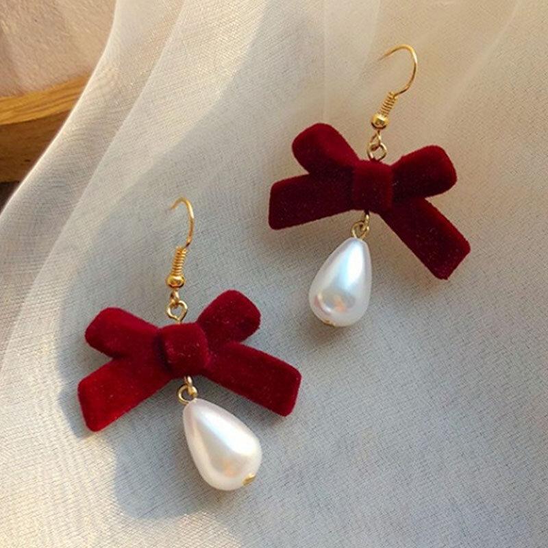 عيد الميلاد الأحمر القوس انخفاض القرط للنساء مزاجه القلب يتدفقون Bowknot عيد الميلاد القرط الفتيات السنة الجديدة مهرجان مجوهرات