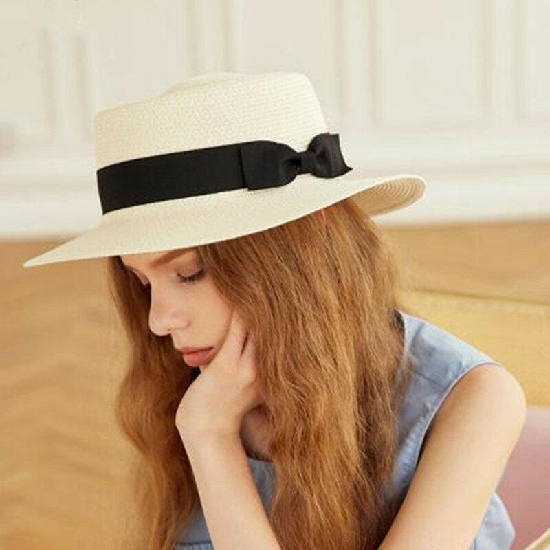 قبعات صيفية للنساء قبعة الشمس السيدات الشاطئ موضة شقة Brom Bowknot بنما سيدة عادية قبعات للحماية من الشمس للنساء القش قبعة