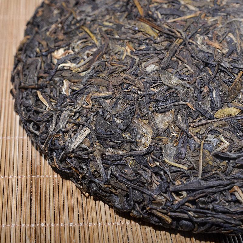 2012 سنة شاي بوير خام صيني يونانا منغاي شين بوير خاص أخضر عضوي Pu-erh كعكة الشاي 357g لانقاص الوزن الغذاء الصحي