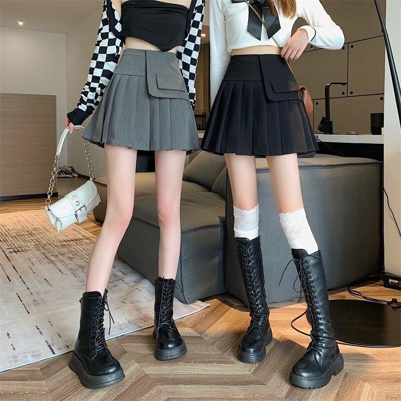 أسود مطوي تنورة المرأة الربيع والخريف عالية الخصر ألف كلمة الورك التفاف تنورة قصيرة تصميم الشعور الأقلية تنورة صغيرة