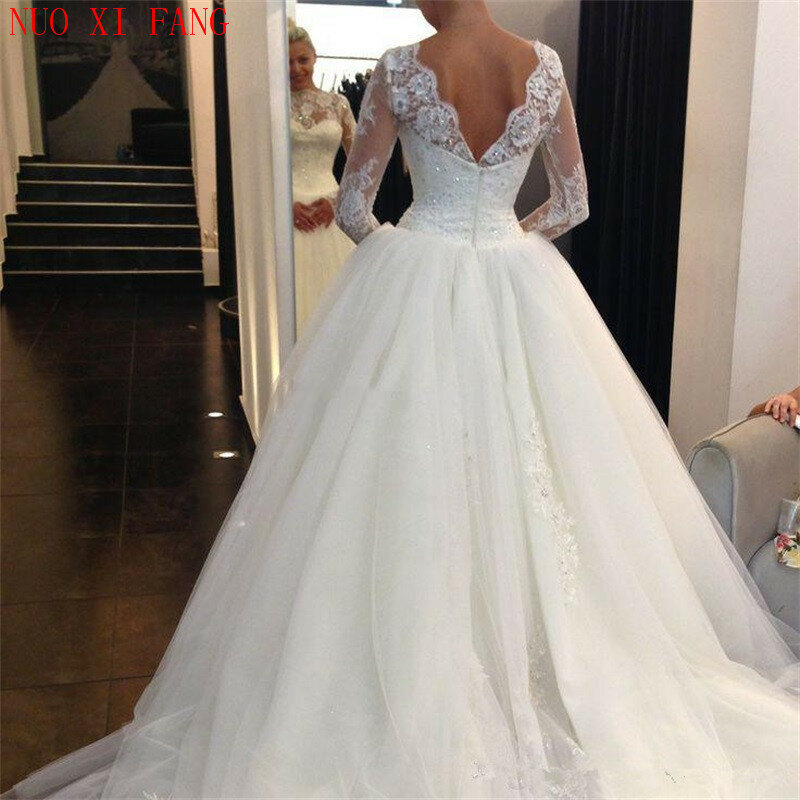 فساتين زفاف من قماش التل بأكمام طويلة من nuoxyfang A Line vestido de noiva بدون ظهر من الدانتيل مزين بالترتر فساتين زفاف رسمية