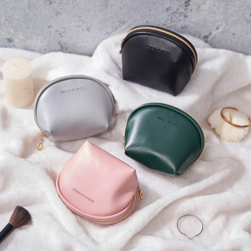 قذيفة صغيرة النساء حقيبة مستحضرات التجميل بولي Leather الجلود سحاب عازل للماء يشكلون حقيبة السفر المحمولة غسل ماكياج المنظم محفظة الجمال