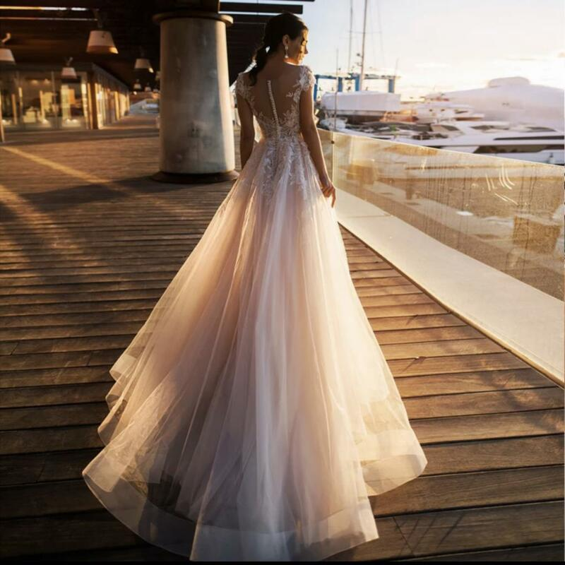 فستان زفاف أنيق جديد 2021 a خط رقبة شفافة كم كاب دانتيل زينة زر تول سويب تراين فستان العروس Vestidos De Noiva